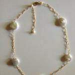 "Necklace: 16"" long with 2"" extension; 14K gold fill fancy Italian chain; 5 large white coin pearls spaced 1"" apart     $220"