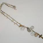Vintage Rosary from 1930's France.made from opalescent glass and brass chain, extender and cross incorporated with a mixture of white freshwater pearls and additional religious medals    $400 MKA302